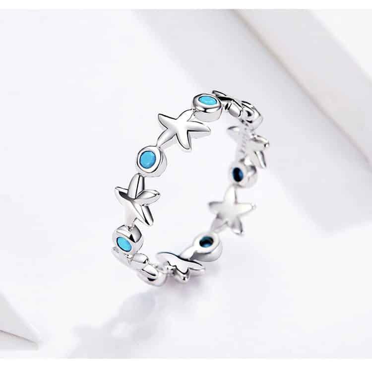 טבעת כסף מקורי עם אבני טורקיז בעיצוב כוכבים